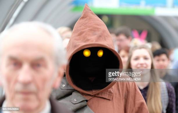 A cosplayer dressed as Jawa character from Star Wars walks on the fairgrounds in Leipzig during the Leipzig Book Fair on March 16 2018 / AFP PHOTO /...