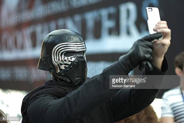 A cosplayer dressed as Kylo Ren attends the New York Comic Con 2016 at The Jacob K Javits Convention Center on October 7 2016 in New York City New...