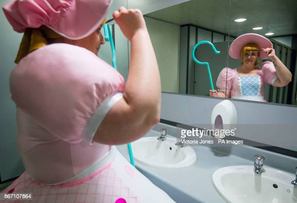 A cosplayer dressed as Little Bo Peep adjusts her costume at the London Comic Con at the ExCel London
