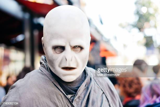 A cosplayer dressed as Lord Voldemort from Harry Potter attends the 2019 ComicCon International on July 19 2019 in San Diego California