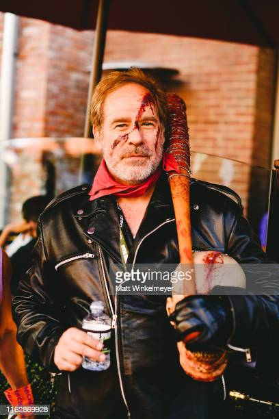 A cosplayer dressed as Negan attends the 2019 ComicCon International on July 18 2019 in San Diego California