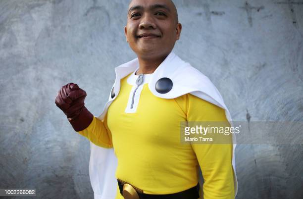 A cosplayer dressed as OnePunch Man poses outside San Diego ComicCon on July 19 2018 in San Diego California Thousands of revelers are arriving for...