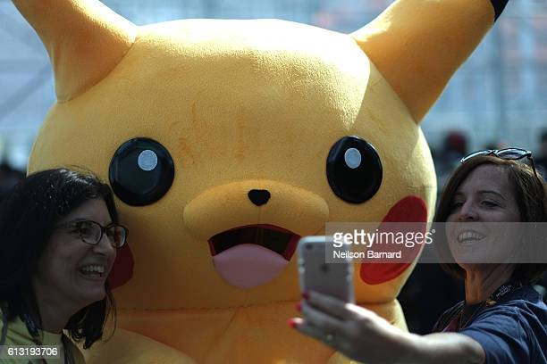 A cosplayer dressed as Pikachu attends the New York Comic Con 2016 at The Jacob K Javits Convention Center on October 7 2016 in New York City New...