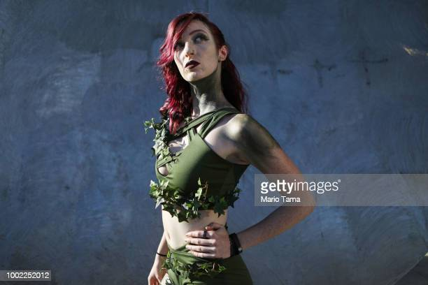 A cosplayer dressed as Poison Ivy poses outside San Diego ComicCon on July 19 2018 in San Diego California Thousands of revelers are arriving for the...