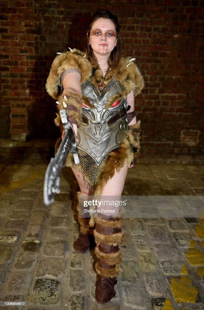 A cosplayer dressed as Savior's Hide of Skyrim poses during