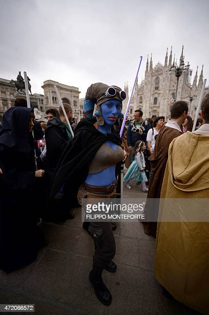 A cosplayer dressed as 'Star Wars' character Aayla Secura stands near Milan's Duomo on May 3 2015 as part of Star Wars Day AFP PHOTO / FILIPPO...