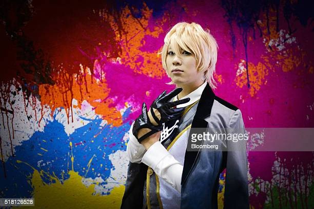 A cosplayer dressed as the character Dr Jekyl and Mr Hyde from Fate/Prottype Fragements of Blue and Silver poses for a portrait at the Anime Japan...