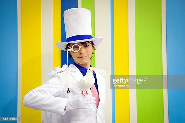 A cosplayer dressed as the character Kaito Kid from Detective Conan poses for a portrait at the Anime Japan 2016 convention in Tokyo Japan on...