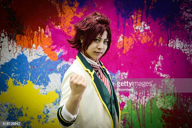 A cosplayer dressed as the character Mao Isara from Ensemble Stars poses for a portrait at the Anime Japan 2016 convention in Tokyo Japan on Saturday...