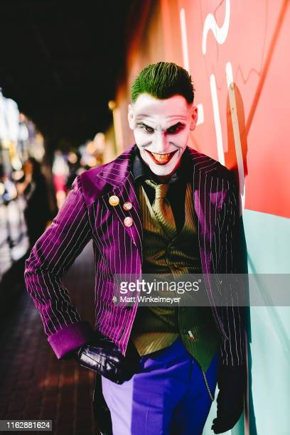 A cosplayer dressed as The Joker attends the 2019 ComicCon International on July 18 2019 in San Diego California