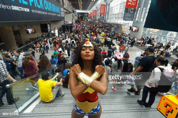 Cosplayer dressed as Wonder Woman attend the 2017 New York Comic Con on October 8 2017 in New York City