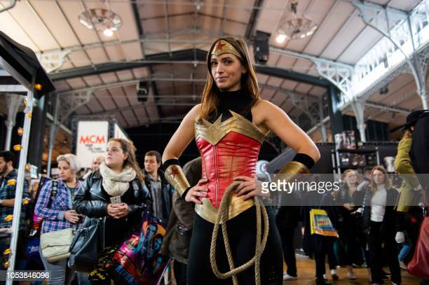 """Cosplayer dressed as Wonderwoman poses for a photograph during the Comic convention """"Comic Con"""" on October 26, 2018 at the Grande Halle de la..."""