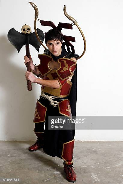 A cosplayer dressed with a costume inspired by the video game 'League of Legends' poses during the Paris Manga SciFi Show at Parc des Expositions...