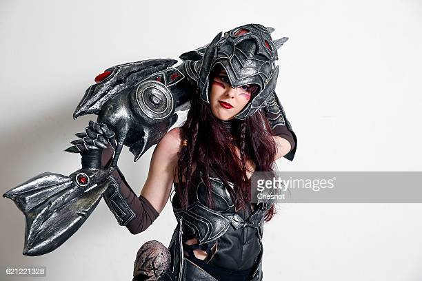 A cosplayer dressed with a costume of the character Caityln inspired by the video game 'League of Legends' poses during the Paris Manga SciFi Show at...