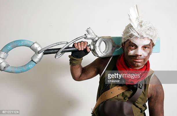 A cosplayer dressed with a costume of the character Erko inspired by the video game 'League of Legends' poses during the Paris Manga SciFi Show at...