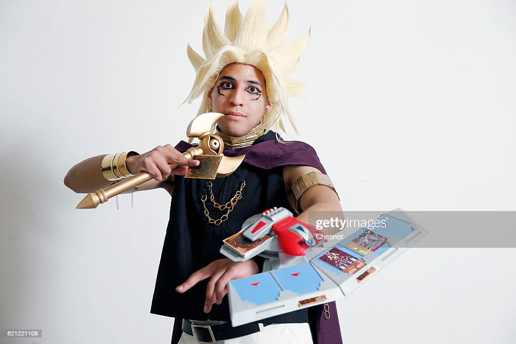 A cosplayer dressed with a costume of the character Marik Ishtar inspired by the manga u0027  sc 1 st  Getty Images & Magnificent Manga Cosplay at Paris Manga u0026 Sci-Fi Show Photo Album ...