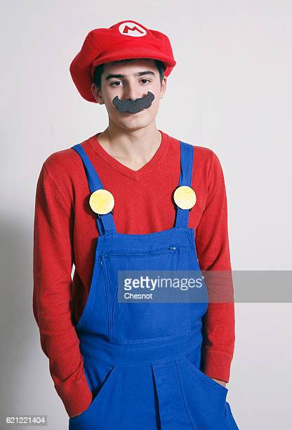 A cosplayer dressed with a costume of the character Super Mario inspired by the video game 'Super Mario' poses during the Paris Manga SciFi Show at...