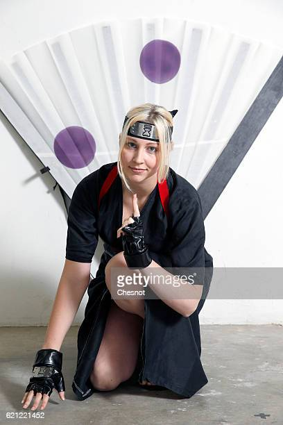 A cosplayer dressed with a costume of the character Temari inspired by the manga Naruto poses during the Paris Manga SciFi Show at Parc des...