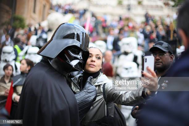 Cosplayer dresses as Darth Vader attends a flashmob during the Star Wars Day 2019 at Piazza di Spagna on May 04 2019 in Rome Italy