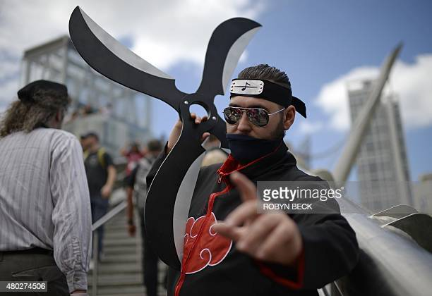 Cosplayer Eric Burke portrays the character Akatsuki from the Japanese manga series 'Naruto' outside the San Diego Convention Center at Comic Con...