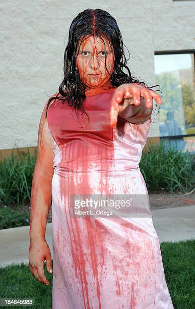 Cosplayer Gabriella Morales dressed as Carrie attends Son Of Monsterpalooza 2013 at Burbank Airport Marriott on October 12 2013 in Burbank California