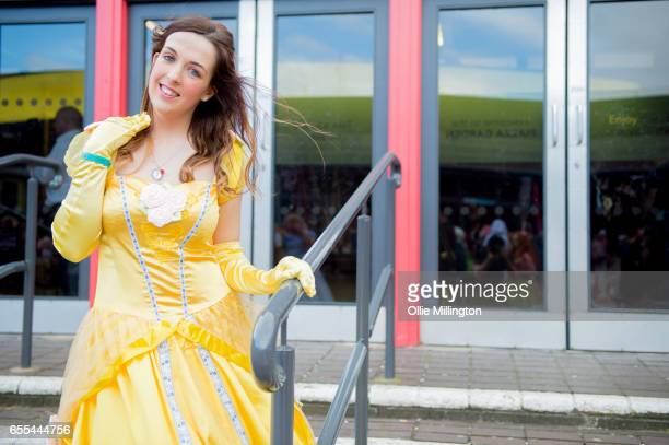 A cosplayer in character as Belle from Beauty and the Beast during the MCM Birmingham Comic Con at NEC Arena on March 19 2017 in Birmingham England