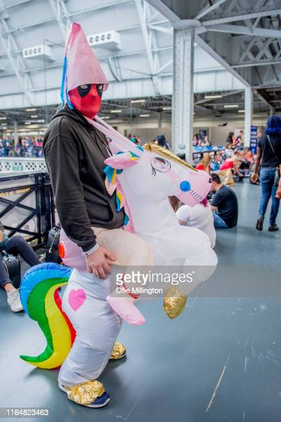 A cosplayer in character as Deadpool riding a Unicorn from the Deadpool 2 trailer seen during London Film and Comic Con 2019 at Olympia London on...