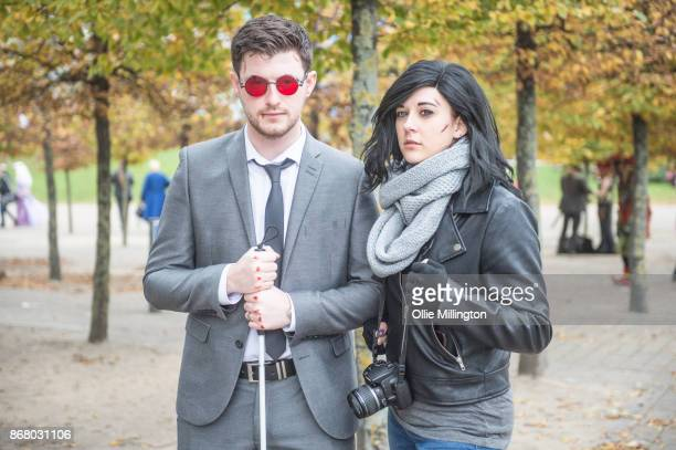 """Cosplayer in character as Matthew """"Matt"""" Murdock and another as Jessica Jonesfrom Marvels Defenders during day 3 of the MCM London Comic Con 2017..."""