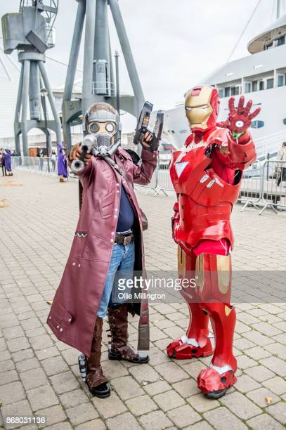 Cosplayer in character as Peter Quill StarLordand one as Iron Man seen during day 3 of the MCM London Comic Con 2017 held at the ExCel on October 29...