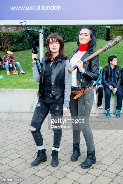 A cosplayer in charcter as JDaryl Dixon and negan with Lucile from The Walking Dead during MCM London Comic Con 2017 held at the ExCel on October 28...