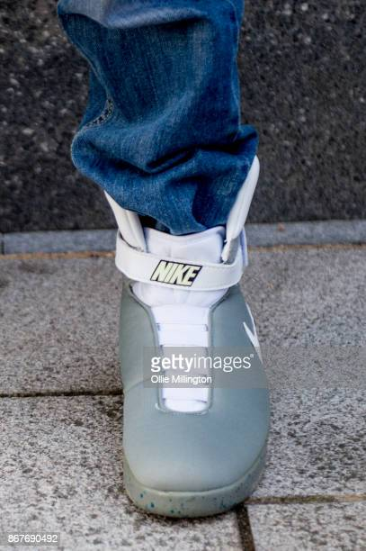 A cosplayer in charcter as Marty Mcfly from Back to the Future wearing the white Nike MAG powerlacing shoes during MCM London Comic Con 2017 held at...