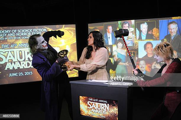 Cosplayer Jesse Oliva as Joker actress Valerie Perez and cosplayer Zoey Garcia as Harley Quinn at the 2015 Saturn Award Nominations for the 41st...