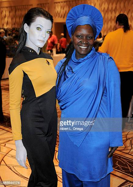 Cosplayer Joanie Brosas as Lt Commander Data from 'Star Trek The Next Generation' and a cosplayer dressed as Guinan at the 14th annual official Star...