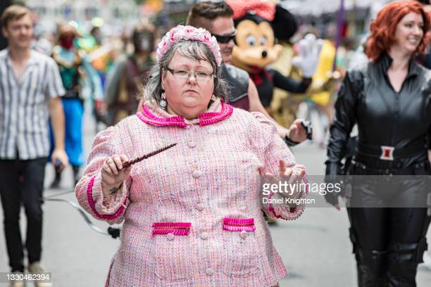 Cosplayer Kel Varner as Dolores Umbridge from Harry Potter marches in a parade of cosplayers down 5th Avenue at the San Diego Causeplayer Community...