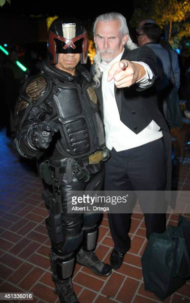Cosplayer Michael Baricante as Judge Dredd with actor Camden Toy attend the After Party for the 40th Annual Saturn Awards held at on June 26 2014 in...