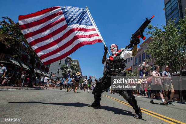 """Cosplayer Nicholas Prior as Dallas from the video game """"Payday 2"""" poses outside 2019 Comic-Con International on July 21, 2019 in San Diego,..."""