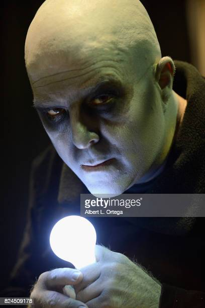 Cosplayer Noel Jason Scott as Uncle Fester attend Day 1 of Midsummer Scream Halloween Festival held at Long Beach Convention Center on July 29 2017...