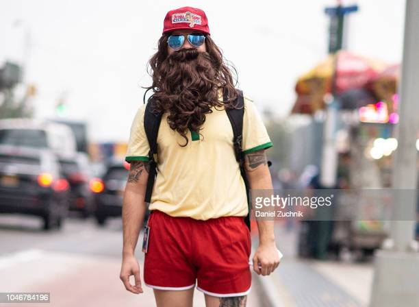 A cosplayer poses as Forrest Gump outside the 2018 New York Comic Con on October 6 2018 in New York City