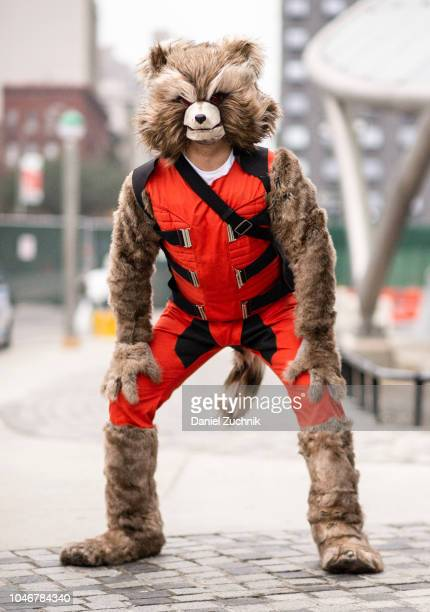 A cosplayer poses as Rocket from Guardians of the Galaxy outside the 2018 New York Comic Con on October 6 2018 in New York City