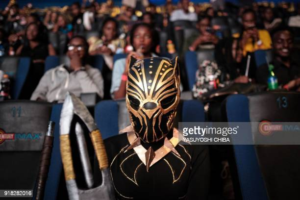 A cosplayer poses before watching the film 'Black Panther' in 3D which featuring Oscarwinning Mexico born Kenyan actress Lupita Nyongo during Movie...