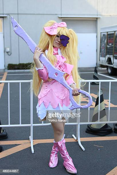 A cosplayer poses for a photograph at AnimeJapan 2014 at the Tokyo Big Sight on March 22 2014 in Tokyo Japan Cosplay is a shortterm for 'costume...