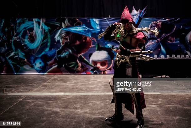 A cosplayer poses in the Lyon Palais des Sports on March 3 2017 during the Lyon eSport#10 event before the start of the League of Legends French...