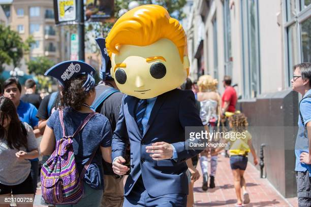 A cosplayer promoting Conan O'Brien's appearance in San Diego walks the Gaslamp District outside ComicCon International on July 22 2017 in San Diego...