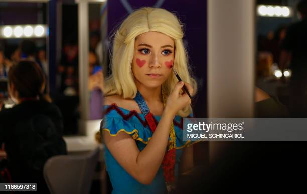 Cosplayer puts on her a make-up at the Comic Con 2019 in Sao Paulo, Brazil on December 5, 2018. - The annual edition of Sao Paulo Comic Con is taking...