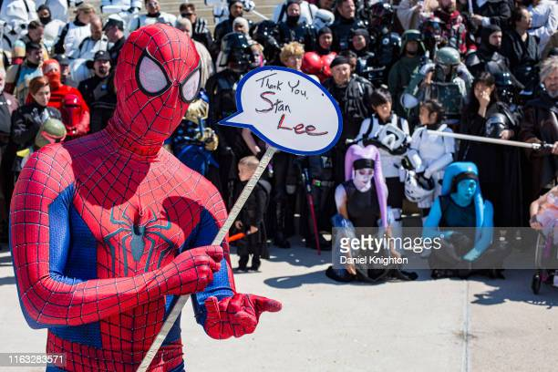 Cosplayer Robert Mundt as Spiderman pays tribute to Marvel founder Stan Lee at 2019 ComicCon International on July 20 2019 in San Diego California