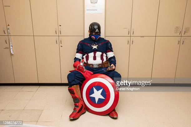 Cosplayer Shawn Richter as Captain America waits to donate blood at San Diego Blood Bank on July 25, 2020 in San Diego, California. With the...