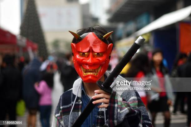 A cosplayer takes part in a costume event at a shopping mall in Hanoi on December 21 2019 Cosplay short for costume play is a subculture originating...