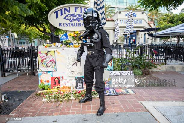 Cosplayer Todd Felton, dressed as a TIE Pilot from Star Wars, poses in front of a Comic-Con Memorial on July 22, 2020 in San Diego, California. 2020...