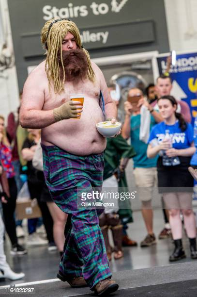 A cosplayer walks onstage in character as Fat Depressed Thor from The Avengers Endgame seen during London Film and Comic Con 2019 at Olympia London...