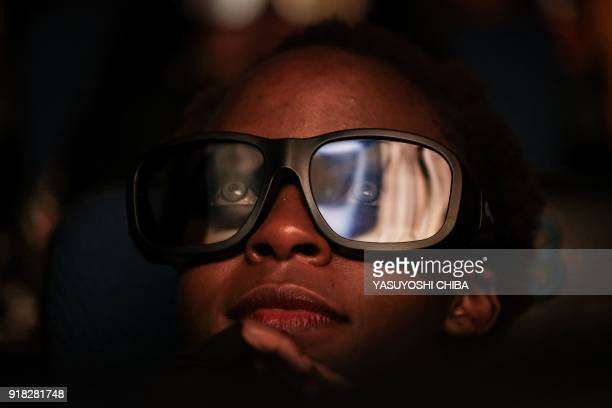 A cosplayer watches the film 'Black Panther' in 3D which featuring Oscarwinning Mexico born Kenyan actress Lupita Nyongo during Movie Jabbers Black...